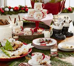 Have fun with your holiday place settings by mixing classic holiday tableware with more fun pieces like this Santa dinnerware.