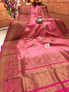Shop Katan Banarasi saree online exclusively with us in silk mark range. This one is available in Coral Pink color with mesh of zari work in the pallu which has a Magenta color and helps to form a perfect contrast to the body color. Coral Saree, Pink Saree Silk, Kanjivaram Sarees Silk, Indian Silk Sarees, Soft Silk Sarees, Wedding Lehenga Designs, Saree Wedding, Benarsi Saree, Sari