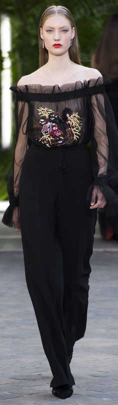 Java corset top and pants.  Black embroidered tulle off-the-shoulder with a coral detail and black crepe pants.