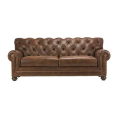 It's easy to love the traditional Chadwick two-cushion sofa in leather, thanks to its prominently rolled arms, distinctive high scalloped back, and deep diamond tufting. An unequivocal statement piece, it's also available in fabric and with or without nailhead trim.