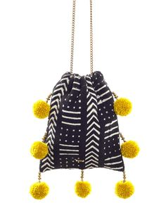 We love this vibrant pom pom bag, perfect for the beach, brunch, and everything in between!