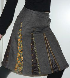 """Sewing Projects The """"ingredients"""" for this skirt were: a pair of old grey wool pants, a pair of old brown, shiny pants and a skirt bought on sale, with a te. - View details for the project Happy new skirt (from sad old pants) on BurdaStyle. Kleidung Design, Diy Kleidung, Diy Clothing, Sewing Clothes, Sewing Jeans, Recycled Clothing, Recycled Fashion, Skirt Sewing, Recycle Jeans"""