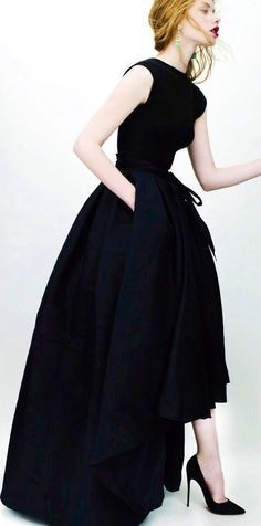 Christian Dior. I love the ascetic neckline combined with the luxurious sweep of skirt.  Grown up, but romantic.
