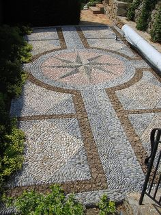 If you're looking for an outdoor project that's a bit off the beaten path, a pebble mosaic will give your yard, garden, or walkway a. Pebble Floor, Pebble Mosaic, Pebble Stone, Stone Mosaic, Pebble Art, Mosaic Pots, Garden Stones, Garden Paths, Garden Art