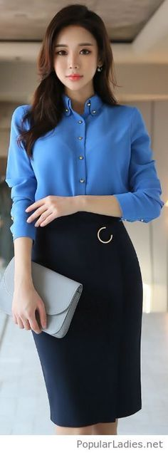Blue shirt and a black skirt with a grey bag