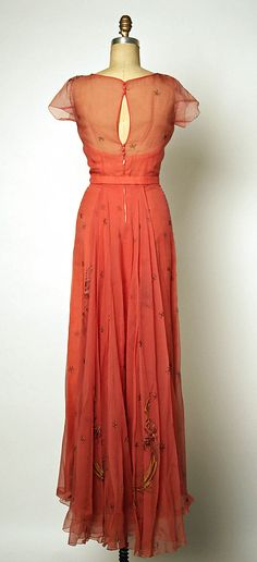 Evening dress Attributed to Gilbert Adrian  (American, Naugatuck, Connecticut 1903–1959 Hollywood, California)  Date: late 1940s Culture: American Medium: silk. Back