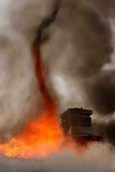 A fire tornado swirls near a chimney on the roof of a burning house. Fire tornadoes occur when intense heat and turbulent wind conditions combine to form whirling eddies of air. All Nature, Science And Nature, Amazing Nature, Tornados, Natural Phenomena, Natural Disasters, Tornado Pictures, Fire Tornado, Fuerza Natural