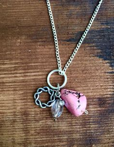 A personal favorite from my Etsy shop https://www.etsy.com/listing/198051515/upcycled-charm-necklace-pink-turquoise