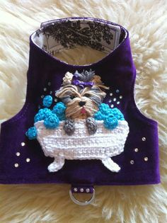 How adorable is this! The Yorkie in a Bathtub harness is hand crocheted with 100% Egyptian cotton. The harness is made of luxurious purple velvet adorned with Swarovski Crystal Elements.