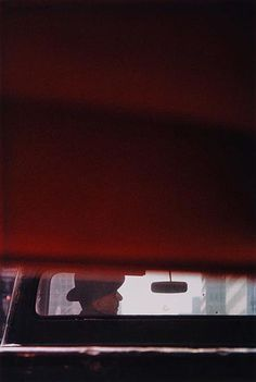 Photograph by Saul Leiter. #portrait #negative_space #profile
