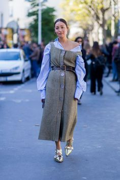 """30 Looks That Show The Many Sides Of """"French Girl"""" Style #refinery29  http://www.refinery29.com/2016/10/125501/pfw-spring-2017-best-street-style-outfits#slide-7  While you're at it, tug your dress and shirt off your shoulder, too...."""