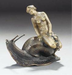 'SNAIL FERRY' A PATINATED BRONZE FIGURAL GROUP -  CAST FROM A MODEL BY IDA BERTHA MEIER