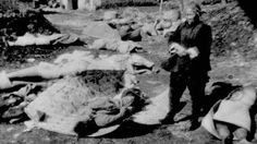 Over 60 years ago, a fate so horrific befell the Chinese city of Nanking that its aftershocks are still being felt today. This undated photo shows a Chinese woman surveying the remains of her family, allegedly killed by Imperial Japanese troops after they took Nanking, China, in December 1937. (The Canadian Press)