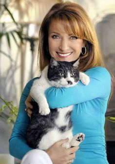 Jane Seymour - hey! She likes cats! This is sort of how she looked when I saw her - with straight hair (no cat though)