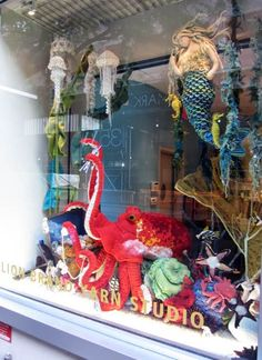 Fiber artists Juliet Hone, Nathan Vincent, and Samantha Smith have brought us yet another gorgeous window display... this time from the depths of the ocean floor! Octavius the Octopus stands...
