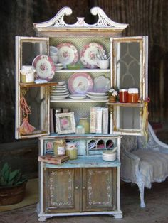 Maritza's GORGEOUSCountry Recipe Desk Painted in distressed white and turquoise. Pink Rose garland painted on lower cabinet doors.  Pink Plates by A Lavender Dilly.  All foods, books and accessories made by  Cynthia Lauren Sperin