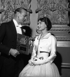 November 1956 - With Gary Cooper in Paris, France. Audrey next to Gary Cooper,who holds the Exhibitors Laurel Award, 1956 Audrey Hepburn Outfit, Audrey Hepburn Born, Audrey Hepburn Photos, Golden Age Of Hollywood, Vintage Hollywood, Classic Hollywood, Hollywood Stars, Gary Cooper, Cary Grant