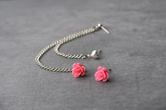 Pretty in Pink Flower Bud and Heart Multiple Pierce Silver Cartilage Earrings (Pair). $11.00, via Etsy.