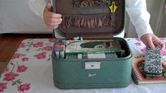 using an old train case as a portable art journal kit - I think we still have mom's old one around here somewhere!