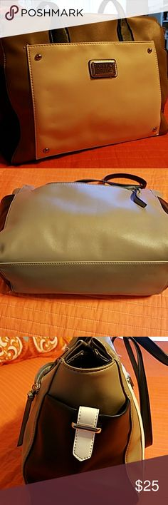 Nicole Miller shoulder bag 3 tone  (Back, tan, white) shoulder bag used vey little. 2 side pockets for drink our cell phone.  One outside zipper for keys and other side has a slide pocket. Inside had large zipper compartment and 3 slots for either cell or credit cards. Full zipper closure at the top and great for work and travel. Nicole Miller Bags Shoulder Bags
