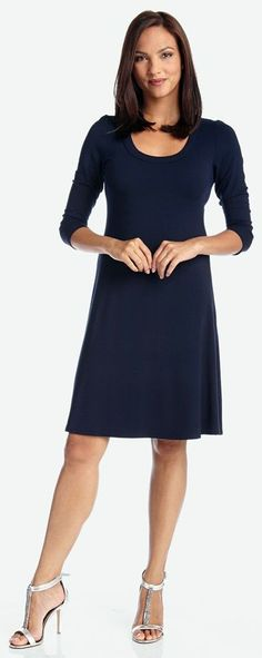 An A-line skirt adds just the right amount of swing to a versatile LBD styled with a scooped neckline and three-quarter sleeves. Dress it up or down for a flattering, sophisticated look.