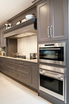 Aidan Design Amazing gray kitchen design with kitchen cabinets painted gray and granite countertops.