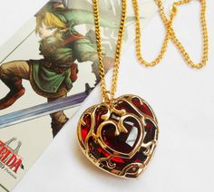 Heart Container Necklace or Key Chain from Much Needed Merch $16.99....the legend of Zelda necklace