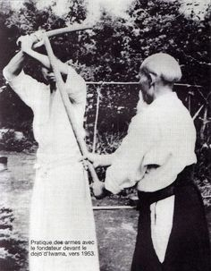 O Sensei and Saito Morihiro Shihan practicing bokken in 1953