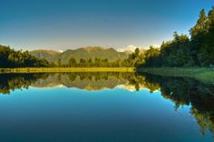 Lake Matheson (aka Mirror Lake), near the Fox Glacier in South Westland, New Zealand, is famous for its reflected views of Aoraki/Mount Cook and Mount Tasman
