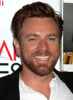 Ewan McGregor. I can't honestly say what it is but I find it truly impossible not to smile when I see his smile. I just can't not smile. His smile is so charming and infectious, I just used a double negative! And I hate those!!