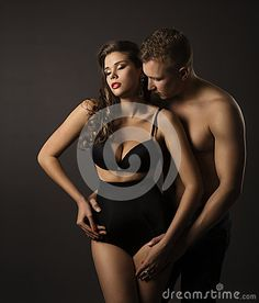 Sexy Couple Woman and Man Portrait, Female in Sensual High Waist Underwear Panties, Kissing Boyfriend over Black Background