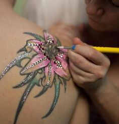 Instead of covering her tattoo for her wedding, she chose to decorate it for her special day. What a great idea!