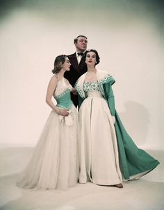 Norman Hartnell posing with models 1953 | By Norman Parkinson
