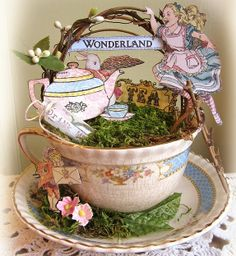 An altered teacup. I like this idea!    Alice in a tea cup -  Crafty Secrets