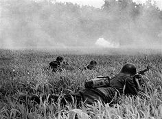 Romanian infantry lying in a field shooting on Russian positions during an attack on the Caucasian front. Russia, August 1942 - pin by Paolo Marzioli