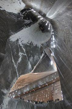 Discover Salina Turda in Turda, Romania: This massive underground salt mine now holds a sci-fi theme park in its depths. Grey Wallpaper Iphone, Salt Cave, Visit Romania, Romania Travel, Retro Futurism, Eastern Europe, Plan Your Trip, Natural Wonders, Traditional Art