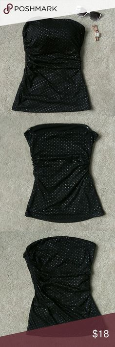 Guess Black Strapless Top with Silver Detail XS/SM Guess Los Angeles Black Strapless Top with Silver Detail. Tag reads, Med but fits like Size XS / Sm. Fits up to 33in bust comfortably 18in length. 16in across top (while laying flat). Dressy black strapless top. Features ruched sides panels & non-slip grip at to hem. In awesome condition! Absolutely no defects. 65% Polyester, 35% rayon. Hand wash, lay flat. Feel free to ask questions. MAKE AN OFFER! FREE GIFT with every purchase! Bundle for…
