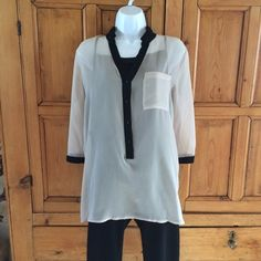 Vera Wang Sheer Blouse with Cami Simply Vera by Vera Wang Cream color sheer blouse with coordinating black cami. Fly back opening in back. Worn once, very pretty. Pair with black pants and your favorite heels. Simply Vera Vera Wang Tops Blouses