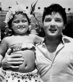 Elvis with Hawaiian native working with him on the set of Paradise Hawaiian style in august 1965.
