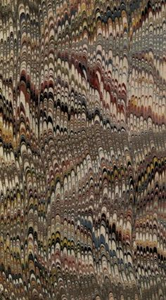 """Combed marbled paper, from an endpaper of a binding of """"Oriental Fragments"""" by Maria Hack, printed in London for Harvey and Dartman, 1828"""