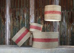 These natural linen lamp shades are rich with texture.The earthy red stripe adds a splash of colour. The linen shade creates a subdued and atmospheric light and can be used for both pendant lights and standing lamps. Decorate your home with these lovely natural linen lampshades. Each stylish lampshade is handmade by skilled artisans. Available in a choice of 4 sizes these beautiful pieces feature a gorgeous red stripe.LinenWide 25.5 x 46cm (dia), Wide 18 x 30cm (dia), Wide 14 x 20cm (dia)…