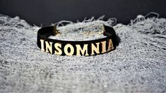 Insomnia Letter Rave Choker Finish off your look with this super cute INSOMNIA Letter Choker necklace.Take your outfit to the next level with this black wooden choker. * Length: 30 cm * Width: 2 cm * Chain link whit lobster clasp * Letters material: wood * Band material: elastic Available
