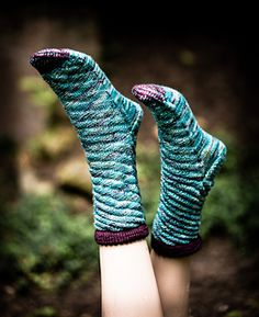 Spiraling around your leg like a waterspout, but far less dangerous, this simple 4x4 biased rib promises hours of storm-free (okay, tantrum-free) knitting. The result? A cuff-down sock that fits even the most hard-to-fit foot, stretching and contracting as needed. Knitting Socks, Free Knitting, Knitting Patterns, Fleece Socks, Stockinette, Sock Yarn, Fingerless Gloves, Arm Warmers, Ravelry