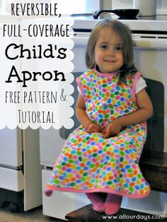 Reversible, Full-Coverage Child's Apron Free Pattern & Tutorial @ AllOurDays.com. Laura is always asking for an apron when I put mine on. Maybe I can trick her into wearing this while she eats.