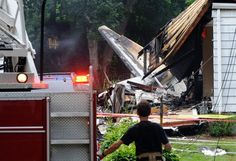 Plane approaching Conn. airport crashes into homes - US news A small plane crashed in a working-class neighborhood near an airport Friday and engulfed two houses in flames, killing at least two people and leaving a third feared dead.
