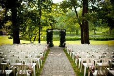 our outdoor ceremony site at The Stone Barn in Kennett Square, PA. We made the aisle decorations; the archway was provided. The scenery was so beautiful that we wanted to keep our decorating simplistic.