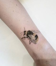 The Realistic Honey Bee Tattoo. The realistic honey bee tattoo with the vibrant color scheme is another great choice for you.
