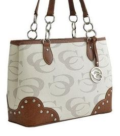 """Signature Studded Shoulder Bag HANDBAG PURSE - BEIGE/BROWN. Size : 13(L) x 9.5(H) x 5(W). Two split compartments & Zip top closure. 9"""" drop double shoulder straps & 20"""" detachable strap included. One wall zip pocket and two pouch pockets inside. Fabric lining & Metal feet on bottom."""