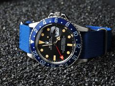 Vintage Rolex GMT-Master with blue bezel and great-looking red arrow.