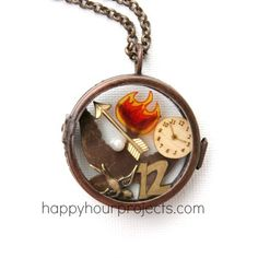 DIY Hunger Games Charm Locket at www.happyhourprojects.com